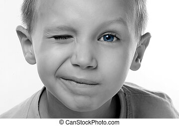 blinking - a boy with blue eyes is blinking