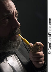 thinking and smoking - thoughtful gentleman is smoking pipe