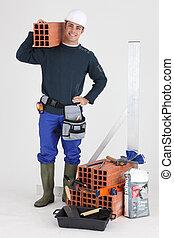 Um, pedreiro, posar, seu, ferramentas, predios, materiais