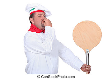 Pizza chef with a wooden peel
