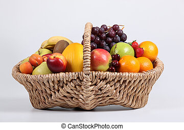 Wicker basket full of fresh fruit