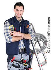 A construction worker posing with his tools