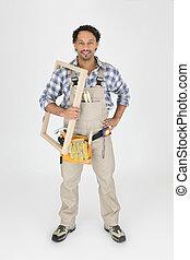 A carpenter holding a frame