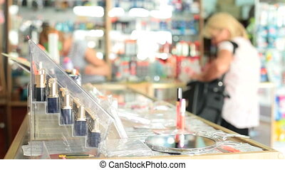 Shopping in Cosmetics Department - Women Shopping in...