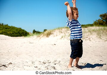 Young Boy with Arms Stretched Looking Happy - Young boy with...