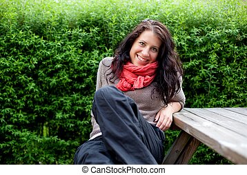 Woman Sitting on a Bench Enjoying the Fresh Air