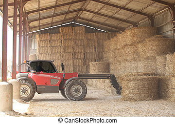 Tractor storing bails of hay