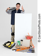 Tile cutter posing by blank poster