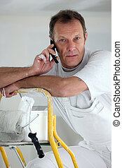 Portrait of a painter on the phone