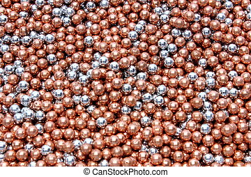 BB Gun Ammo - Isolated bronze and silver .177 caliber BB's...