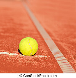 tennis ball on clay court