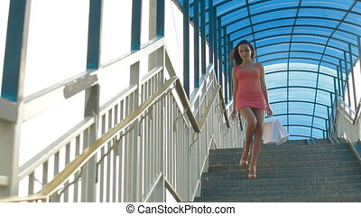 Woman Walking with Shopping Bags - Beautiful Young Woman...
