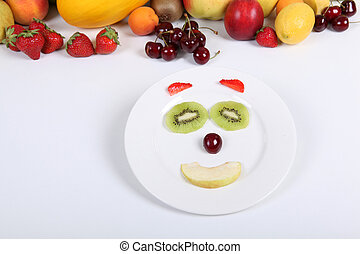 Various fruit arranged into smiley face