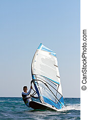 Windsurfer passing by - Front view of a windsurfer passing...