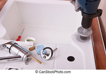 a sink and plumbing pieces and tools