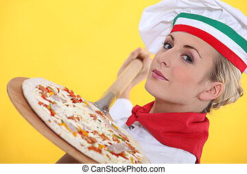 chef making a pizza