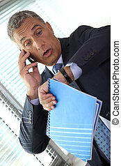 Shocked businessman realizing he is late