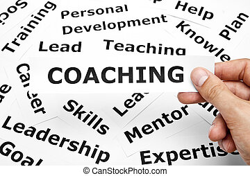 Coaching concept - Hand holding a piece of paper with...