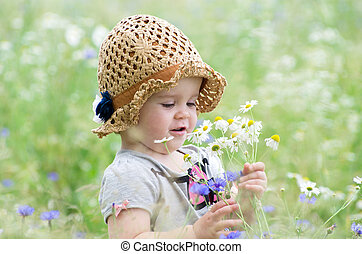 baby girl outdoors at sunny summer day