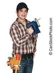 Man holding a jigsaw.