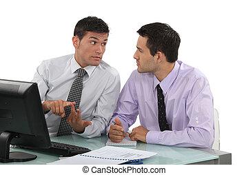 Businessmen at a desk