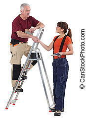Co-workers with a stepladder