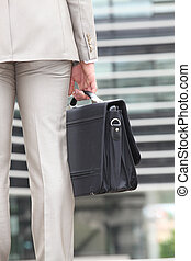 Closeup of a man carrying a briefcase