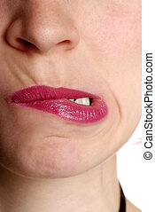 woman with red lip - detail of a face with red lip and tooth...