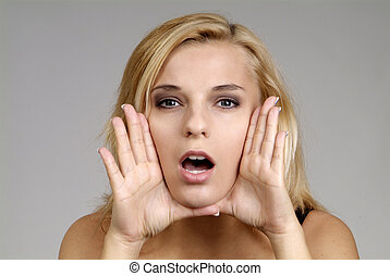 woman cries - a pretty blond woman with hand and open mouth