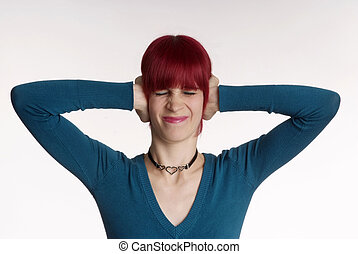 Woman keeps ear closed - a woman with red hair and turned...