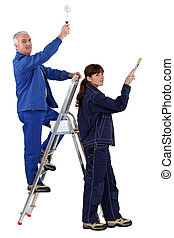 Man and woman redecorating