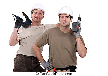 Manual workers with power tools