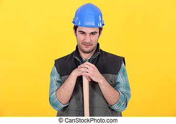 Manual worker stood with large hammer