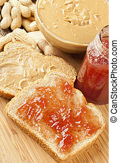 Homemade Peanut Butter and Jelly Sandwich against a...