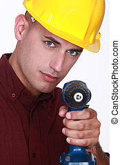 Man with an electric screwdriver