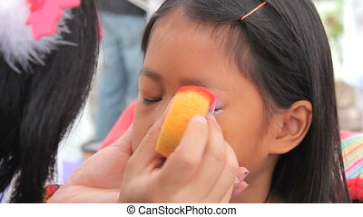 Asian Girl Has Eyes Face Painted - A cute little 6 year old...