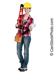 Tradeswoman holding large clippers and rolled-up drawings