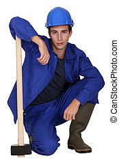 Young worker with a sledgehammer