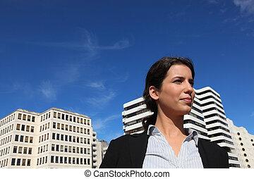 a business woman walking near buildings