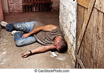 The addict overdose - Overdose addict against the basement