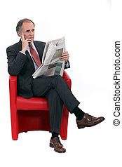 Mature businessman with a newspaper