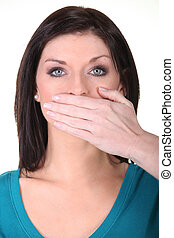 Woman with her hand over her mouth