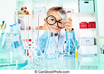 experiment - Cute boy is making science experiments in a...