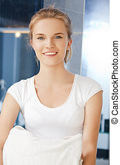 smiling teenage girl with towels - picture of smiling...