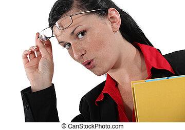 secretary taking off her glasses