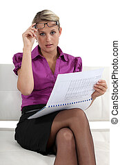 Businesswoman reading a report