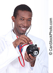 Man using a stethoscope to check the health of a piggy bank