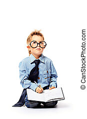 smart boy - Portrait of a little boy in spectacles reading a...