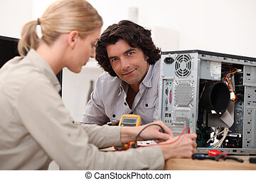 Woman fixing a computer