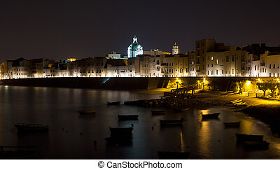 Trapani - Nightview of sea and coast. Trapani, Sicily -...
